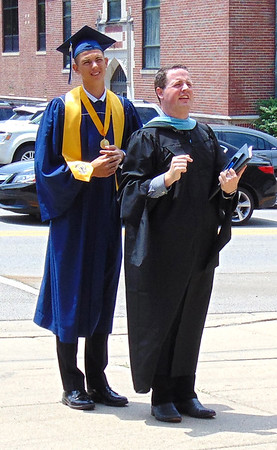 Diane Raver | The Herald-Tribune<br /> Assistant principal Jonathon Maple (right) lined students up for a class photo.