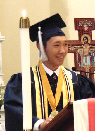 "Diane Raver | The Herald-Tribune<br /> Love ""is what gives us a goal that we can strive for and serves as a guide to achieve that very goal,"" revealed salutatorian Liam Mungcal. ""It is what gives us our purpose and motivation."""