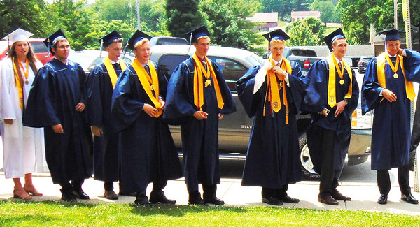 Diane Raver | The Herald-Tribune<br /> The seniors lined up outside prior to graduation.