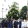 Diane Raver | The Herald-Tribune<br /> The graduates celebrated their accomplishments by tossing their caps in the air.