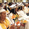 Diane Raver | The Herald-Tribune<br /> Students sit quietly as they wait for their other classmates to receive their diplomas.