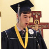 Diane Raver | The Herald-Tribune<br /> Luke Ruter read the first reading during the Mass.