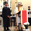 Diane Raver | The Herald-Tribune<br /> Cori Hammoor (right) and Sergio Dole read the prayers of the faithful.