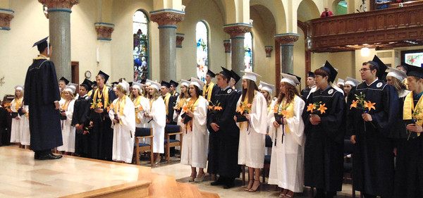 Diane Raver | The Herald-Tribune<br /> Liam Mungcal led his classmates in singing the school's mater prior to the turning of the tassels.