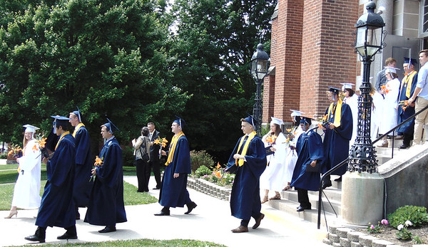 Diane Raver | The Herald-Tribune<br /> Members of the Class of 2017 leave the chapel after receiving their diplomas.
