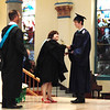 Diane Raver | The Herald-Tribune<br /> Samuel Fairchild receives his diploma and is congratulated by President Diane Laake as principal Brian McFee waits to hand the young man the class flower.