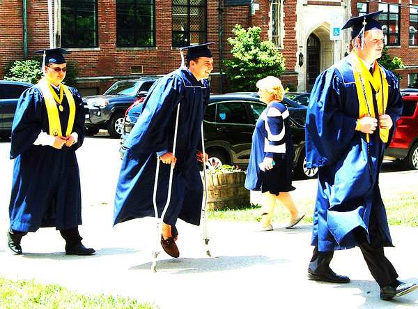 Diane Raver | The Herald-Tribune<br /> Crutches didn't stop Cole Russell from making his way up the sidewalk to the chapel.