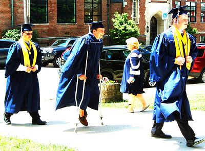 Diane Raver | The Herald-Tribune Crutches didn't stop Cole Russell from making his way up the sidewalk to the chapel.