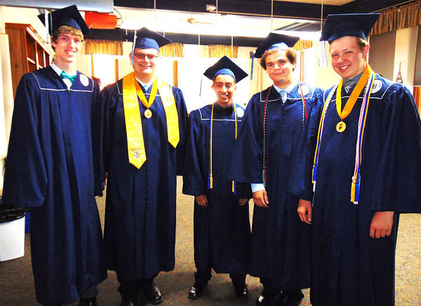 Diane Raver | The Herald-Tribune<br /> Sam Fairchild (from left), Seth Schutte, Edgar Dole, Zach West and Kyle Eckstein were ready to graduate.