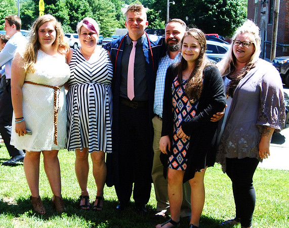 Diane Raver   The Herald-Tribune<br /> Branson Schonfeld and his family celebrate after the graduation.