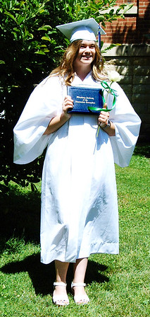 Diane Raver | The Herald-Tribune<br /> Amelia Prickel proudly holds her diploma.