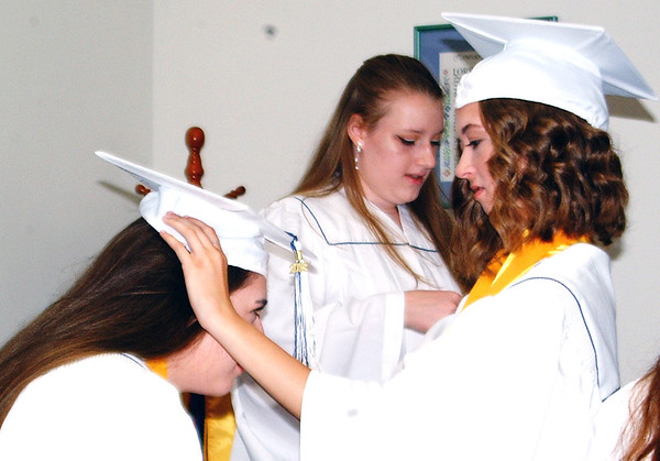 Diane Raver | The Herald-Tribune<br /> Seniors get ready before the ceremony.