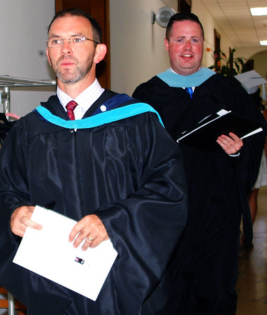 Diane Raver | The Herald-Tribune<br /> Principal Brian McFee (left) and assistant principal Jonathan Maple make final preparations prior to the ceremony.