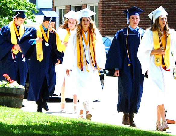 Diane Raver | The Herald-Tribune<br /> Seniors make their way to the chapel.