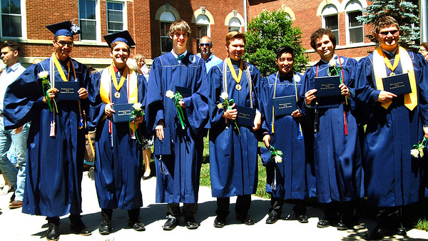 Diane Raver | The Herald-Tribune This group of friends showed off their diplomas after the ceremony.