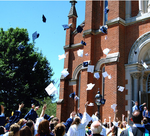Diane Raver | The Herald-Tribune<br /> After all the graduates exited the chapel, the hats flew off.