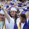 Pelham High School graduation. Graduates turn their tassels, including Melyssa Demers, left, Morgan Apkarian, center, and Riley Williams, right. (SUN/Julia Malakie)