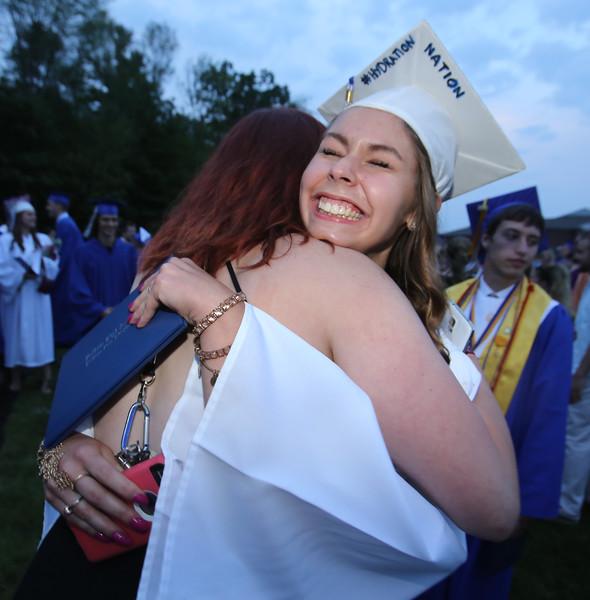 Graduate Taylor Bedard hugs her cousin Seanna Cloutier, 17, of Salem  N.H., after Pelham High School graduation. (SUN/Julia Malakie)