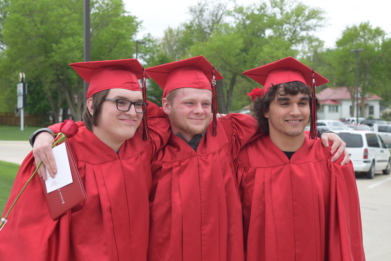 -Messenger photo by Peter Kaspari<br /> <br /> Alex Bergen, left, Gunnar Arends and Bradley Butler all pose for a photo after the Pocahontas Area High School graduation ceremony Sunday.