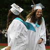 Shawsheen Tech graduation. Salutatorian Quinn Ferreira of Tewksbury, left, and valedictorian Jessica Turner of Wilmington cross paths between their speeches. (SUN/Julia Malakie)
