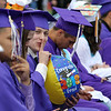 Shawsheen Tech graduation. Robert Danehy of Tewksbury tries to surreptitiously blow up a beach ball. (SUN/Julia Malakie)