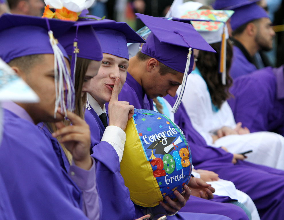 . Shawsheen Tech graduation. Robert Danehy of Tewksbury tries to surreptitiously blow up a beach ball. (SUN/Julia Malakie)