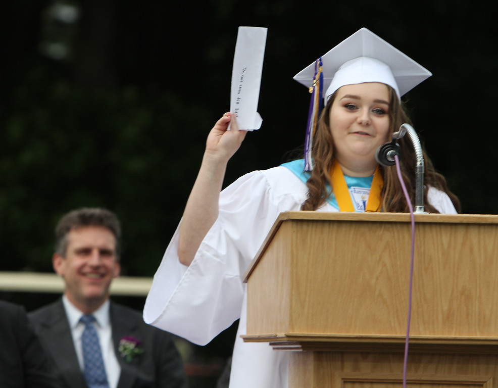 ". Shawsheen Tech graduation. Salutatorian Quinn Ferreira of Tewksbury holds up the enveloper from a letter she wrote to herself in 4th grade, which she read during her speech. It says ""Do not open till 2018, and she recently opened. At left is guest speaker Secretary of Housing and Economic Development Jay Ash. In the letter, her ambition was to become a ballet dancer; now it\'s to become a nurse. (SUN/Julia Malakie)"