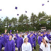 Caps fly at the end of Shawsheen Tech graduation.  (SUN/Julia Malakie)