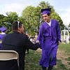 Shawsheen Tech graduation. Electrical shop teacher Anthony Bagni of Burlington, left, congratulates Lucas DosSantos of Billerica, one of his students. (SUN/Julia Malakie)