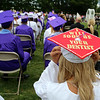 Shawsheen Tech graduation. Julia Hitchcock of Billerica tries to secure her cap in the wind. (SUN/Julia Malakie)