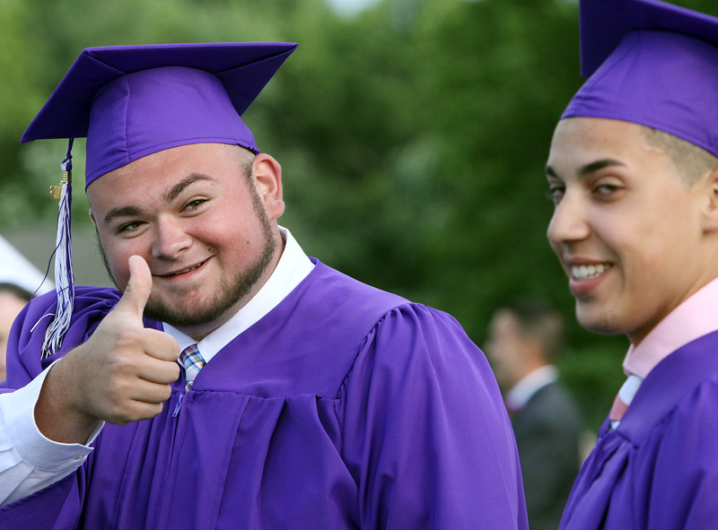 Shawsheen Tech graduation. Thomas Ferraro of Billerica, left, and Brandon Fernandes of Tewksbury, after receiving diplomas. (SUN/Julia Malakie)