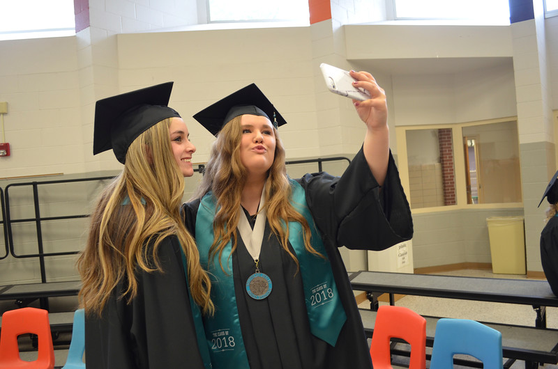 - Messenger photo by Kriss Nelson<br /> <br /> Chelsea Mitchell and Halle Grimm pose for a selfie prior to their graduation at Southeast Valley High School in Gowrie on Sunday.