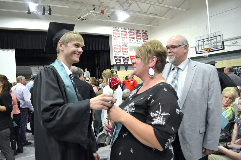-Messenger photo by Kriss Nelson<br /> <br /> Noah Jepson, a 2018 graduate of Southeast Valley High School delivers a rose to his mother, Angie Jepson while his father, Troy Jepson looks on.