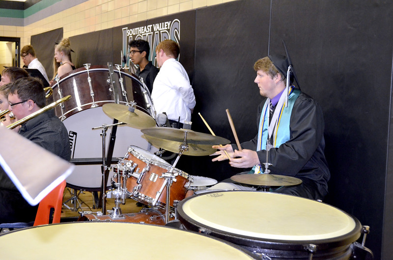 """- Messenger photo by Kriss Nelson<br /> <br /> Thomas Lennon plays the drum set during his graduation at Southeast Valley High School in Gowrie. Lennon and his bandmates played """"How Far I'll Go"""" during commencement."""