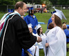 Springfield High School Principal Charles Rittenhouse congratulates  Class of 2014 members as they recieve their diplomas during their Commencement Excercises on Tuesday June 11,2014. Photo by Mark C Psoras/The Reporter