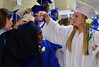 Springfield High School Class of 2014 member Malik Ball has his cap adjusted by faculty member Ashley Fusarelli (L) and classmate Courtney Ameye as they line up for their Commencement Excercises on Tuesday June 11,2014. Photo by Mark C Psoras/The Reporter