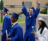 Springfield High School Class of 2014 members show their exuerberance as they march to the stadium field for their Commencement Excercises on Tuesday June 11,2014. Photo by Mark C Psoras/The Reporter