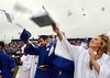 Springfield High School Class of 2014 members toss their caps at the conclusuion of their Commencement Excercises on Tuesday June 11,2014. Photo by Mark C Psoras/The Reporter