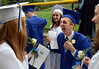 Springfield High School Class of 2014 members share a laugh together as they march to the stadium field for their Commencement Excercises on Tuesday June 11,2014. Photo by Mark C Psoras/The Reporter