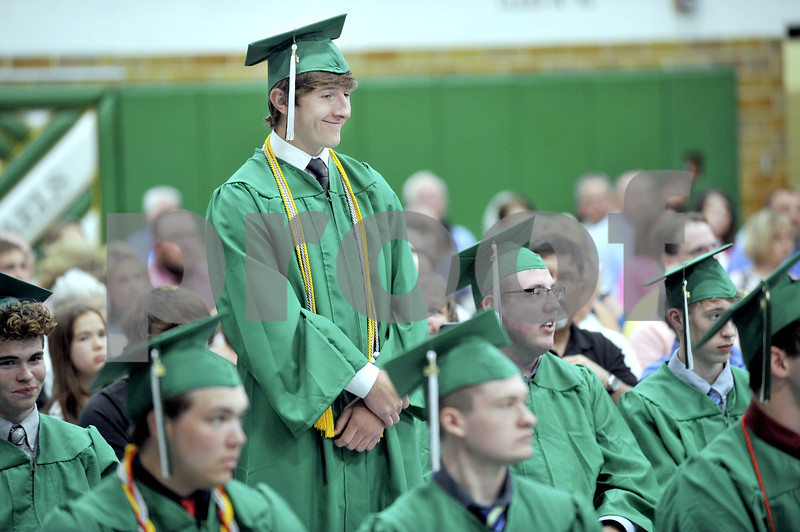 -Messenger photo by Hans Madsen<br /> <br /> Attending his second graduation, this time in green, Isaac Lursen is recognized Sunday afternoon at the St. Edmond Catholic High School commencement. Lursen graduated from Iowa Central Community College May 10.