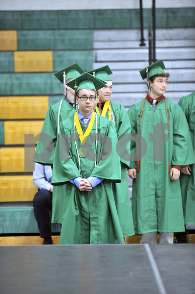 -Messenger photo by Hans Madsen<br /> <br /> Sam Loerts looks a little nerveous as he's about to take the stage to receive his diploma Sunday afternoon during the St. Edmond Catholic High School commencement. Loerts was one of the first students in line.