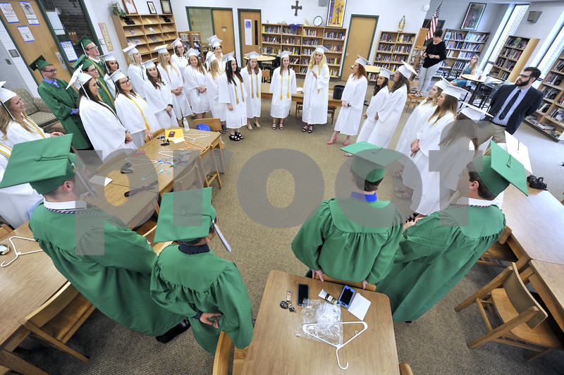 -Messenger photo by Hans Madsen<br /> <br /> The St. Edmond Catholic High School Class of 2018 gathers in a circle Sunday morning as class president Haley Ledford talks to them one last time as a group.