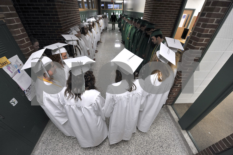 -Messenger photo by Hans Madsen<br /> <br /> The St. Edmond Catholic High School Class of 2018 gathers in the hall for one last prayer together Sunday afternoon before the start of commencement.