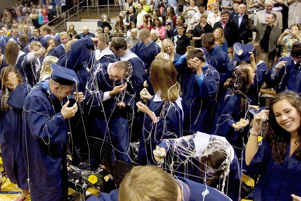 Record-Eagle/ Keith King<br /> Traverse City St. Francis High School graduates clean silly string off themselves Sunday, June 6, 2010 which was sprayed once they were announced as the Class of 2010.