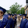 "Record-Eagle/ Keith King<br /> James Alpers, from left, 18, Roger Belanger, 18 and Liza Armour, 17, all of Traverse City, wait outside of the Traverse City St. Francis High School gymnasium Sunday, June 6, 2010 prior to the start of the St. Francis High School graduation ceremony. ""Is anyone here as nervous as I am,"" Roger said."