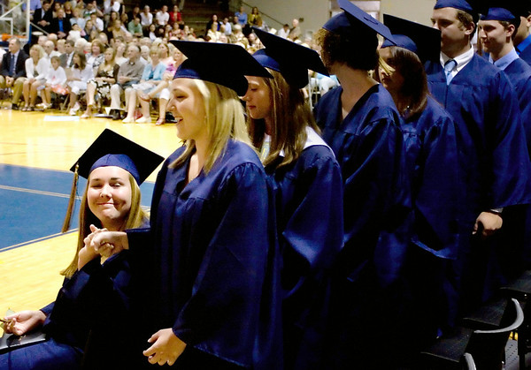 Record-Eagle/ Keith King<br /> Lauren LaMonde, right, gets a fist bump from classmate, Lauren Adams, prior to walking onstage to accept her diploma Sunday, June 6, 2010 during the Traverse City St. Francis High School graduation ceremony in the St. Francis High School gymnasium.