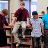 Record-Eagle/Jan-Michael Stump<br /> Traverse City Christian seniors have a moment of prayer together in the school library before Saturday's commencement.