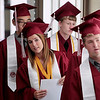 Record-Eagle/Jan-Michael Stump<br /> Traverse City Christian senior Callie Kostrzewa lines up with classmates in the school hallway for Saturday's commencement.
