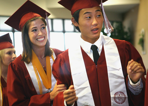 Special to the Record-Eagle/ Heather Rousseau <br /> Lindsay Kostrzewa, 18, and Taehoon Kim, 19 graduates with Traverse City Christian School, anticipate their grand entrance during the ceremony at East Bay Calvary Church on Saturday, June 12, 2010.