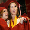 Special to the Record-Eagle/ Heather Rousseau <br /> Leah Beemer, left and Lindsay Kostrzewa, both 18,  share a duet during a group song at their graduation ceremony with Traverse City Christian School at East Bay Calvary Church on Saturday, June 12, 2010.